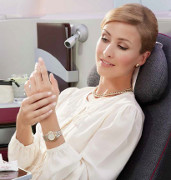 image of a passenger relaxing while sitting on a Business Class seat
