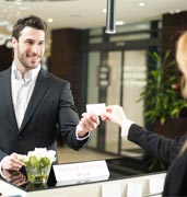 Image of customer and receptionist at a hotel