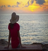 image of woman looking at sunset in larnaca in cyprus