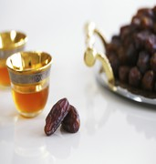image of dried dates and arabic tea in hofuf in saudi arabia