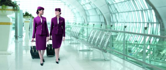 Two female cabin crew in an airport