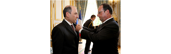 President of the Republic of France, Mr. Francois Hollande confers upon His Excellency Mr. Akbar Al Baker the prestigious Honor of 'Officier de la Légion d'Honneur'