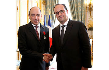 President of the Republic of France, Mr. Francois Hollande congratulates His Excellency Mr. Al Baker on receiving the Officier de la Légion d'Honneur.
