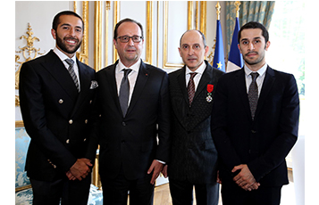 Mr. Francois Hollande and Mr. Al Baker with Mohammed Al Baker (left) and Hussain Al Baker (far right).