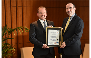 Keith Hunter, QDF Senior Vice President (left) and Nicholas Palmer, QDF Vice President Food and Beverage (right) holding the ISO certificate.