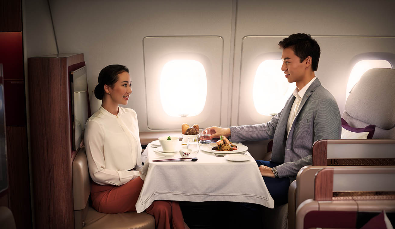 Image of couple having fine dining in Qatar Airways Airbus 380 first class