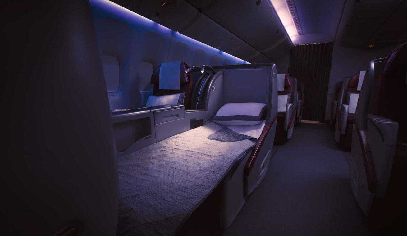 Image of Qatar Airways Boeing 777 business class seat lie flat