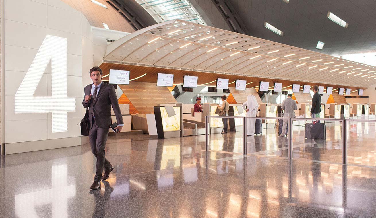 Image of a passenger in Hamad International Airport in the check-in area