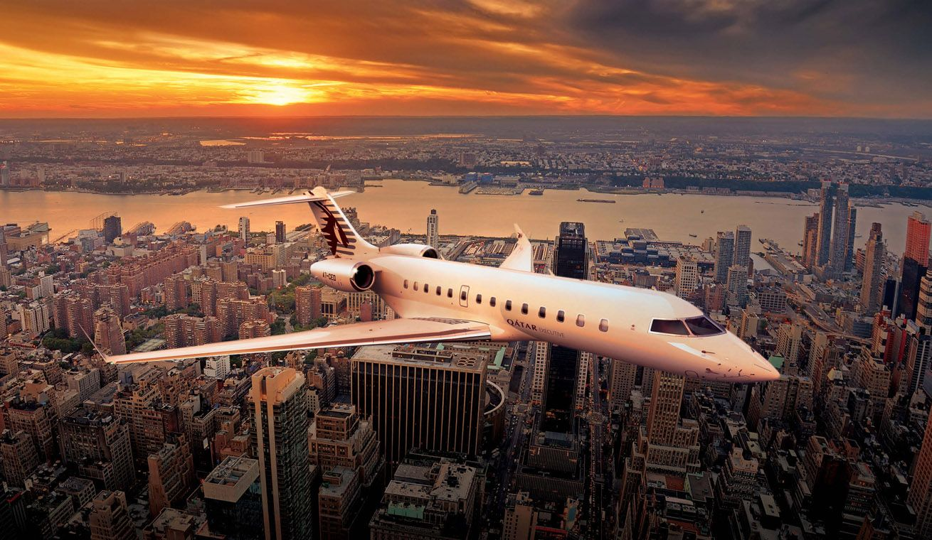 A panoramic image of the Global 5000 aircraft used for Qatar Executive passengers with a backdrop of a city line with skyscrapers