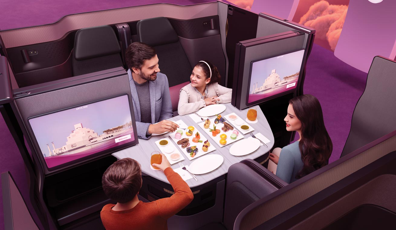 Image of an European family dining in a Qsuite.