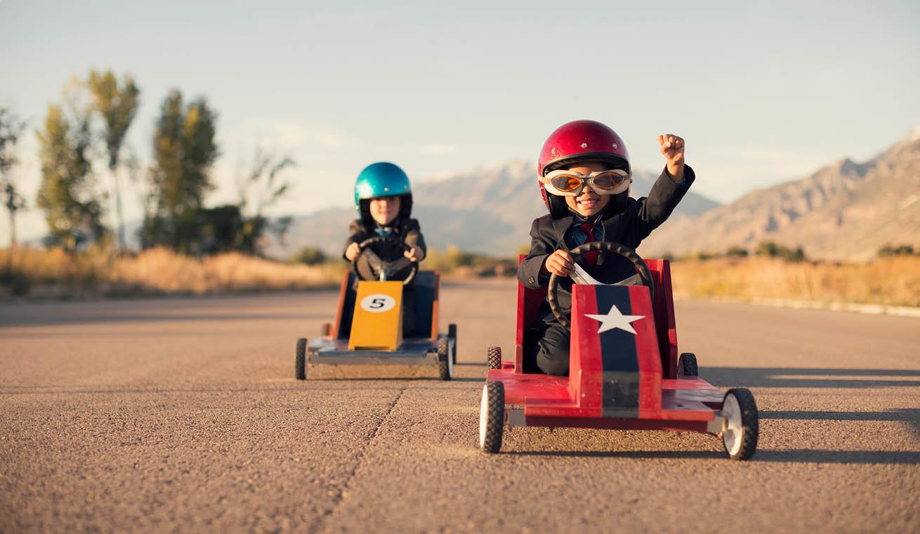 Image of two kids kart racing