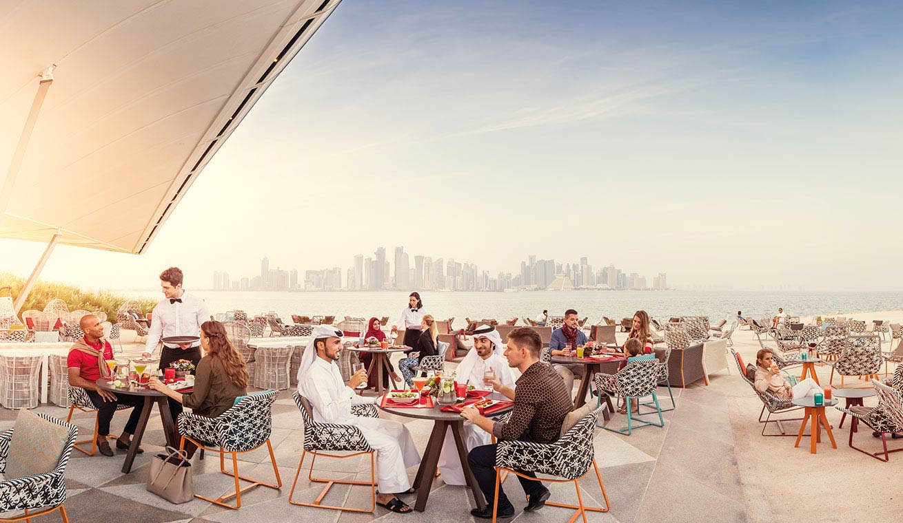 Image of a busy cafe terrace in Doha, Qatar