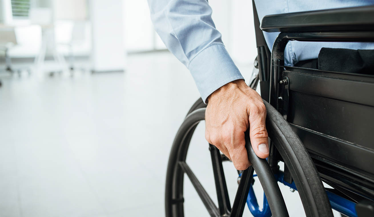 Image of a man on a wheelchair