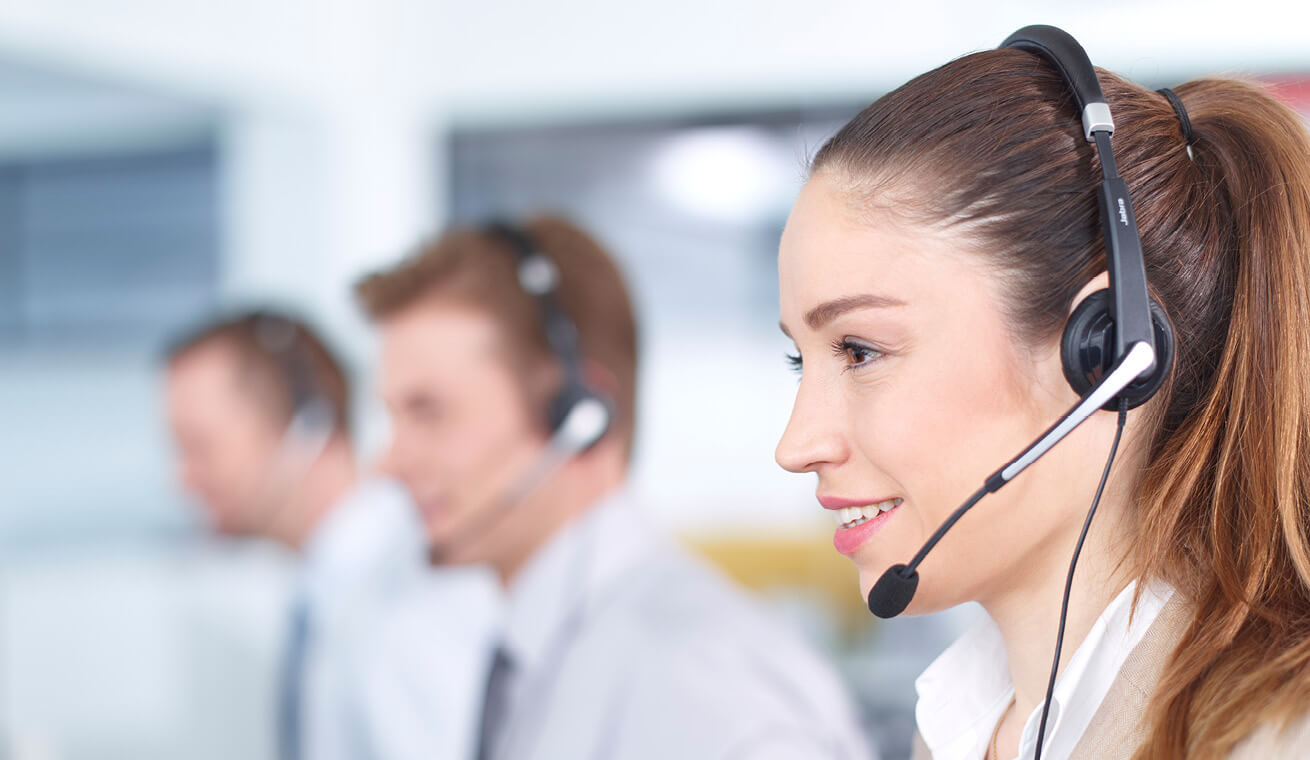 Image of three call centre agents talking with headphones