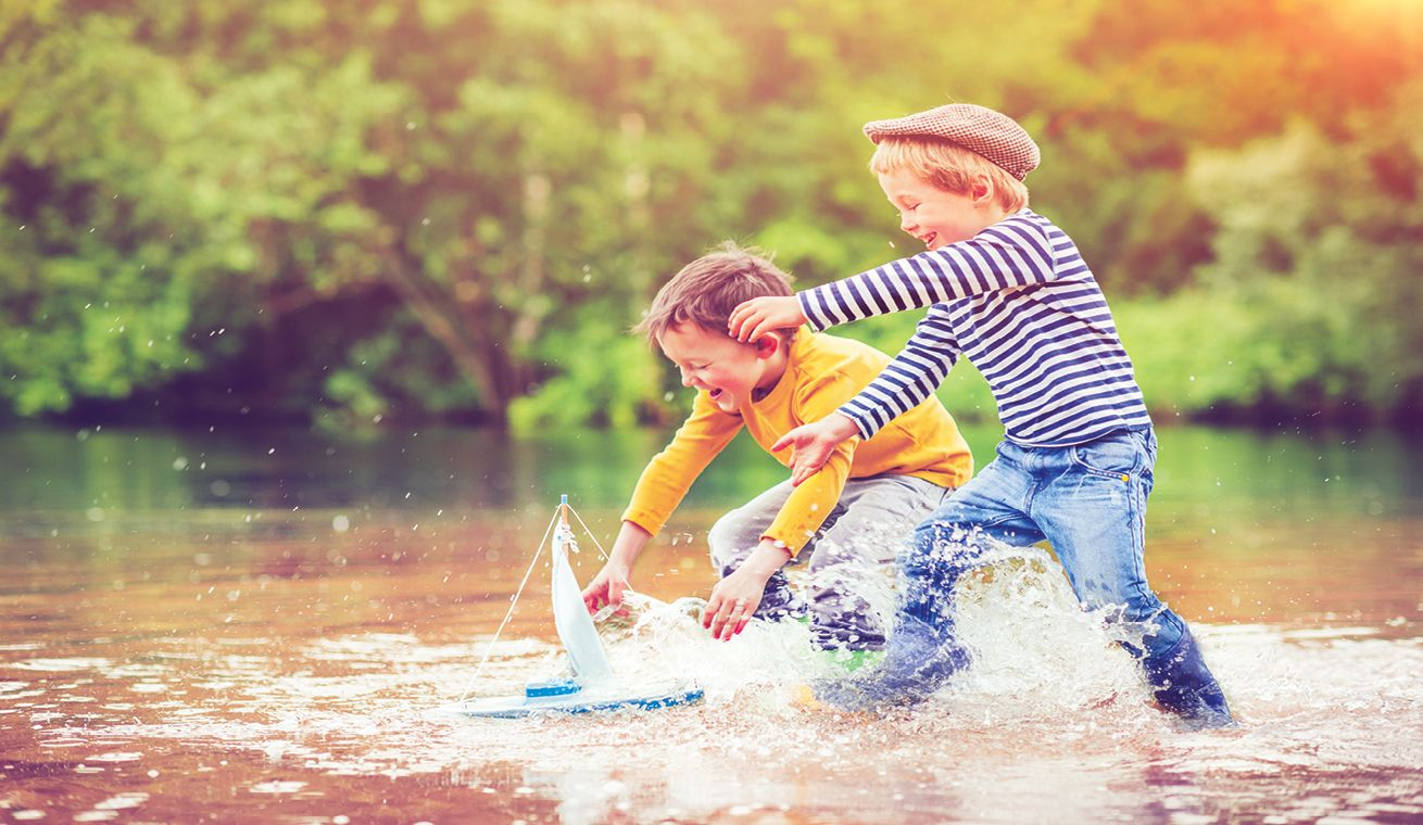 Image of kids playing in a shallow lake